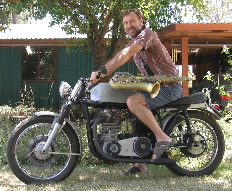 Photo of Jim on bike with sax